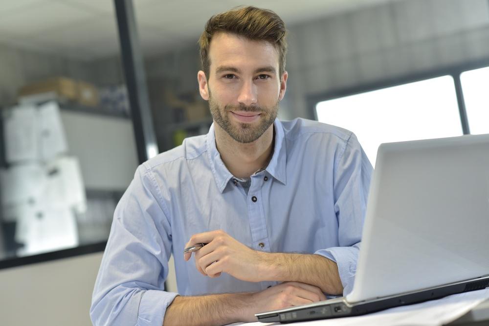 Businessman in office working on laptop.jpeg