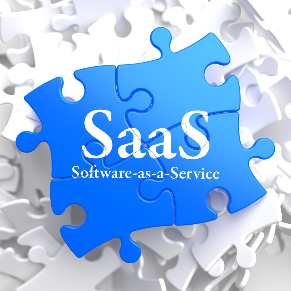SAAS - Software-as-a-Service - Written on Blue Puzzle Pieces. Information Technology Concept. 3D Render..jpeg