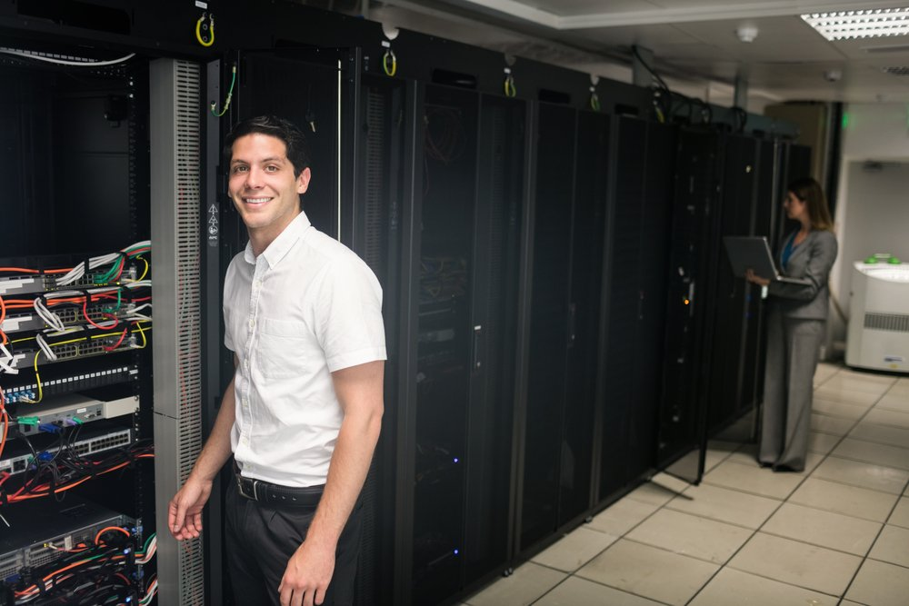 Team of technicians working on servers at the data centre