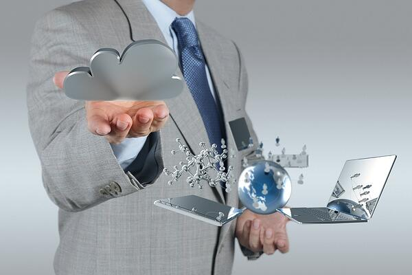businessman hand shows cloud network and new technology symbol concept